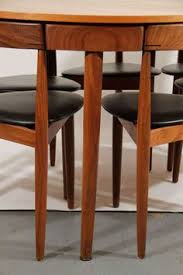 hans olsen teak dining table with extension and six chairs image 2