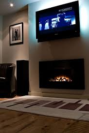 tv mounted above fireplace shoulder muscles fireplaces and televisions