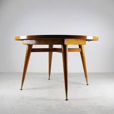a dining table in sycamore and golden brass 1960