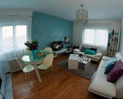 Impressive Small Apartment Living Room Design Layout With Blue Ocean Wall  Colour And Confort Cream Sofa