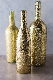 supplies three assorted sized wine bottles assorted gold glitter decou page paintbrush