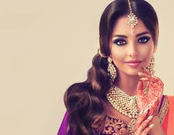 portrait of beautiful indian young hindu woman model with tatoo mehndi and kundan jewelry traditional indian costume lehenga choli
