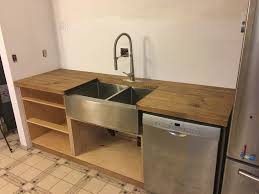 diy wood kitchen countertops while planning out our kitchen remodel we debated between all of the standard countertop materials laminate stone quartz