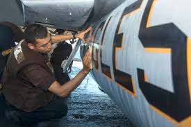 u s department of defense photo essay u s navy seaman john guerrero cleans the fuel tank of an f a 18e