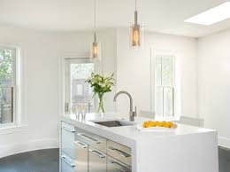 splashy sonneman lighting in kitchen modern with metal pendant lights next to pendant lights for kitchens alongside stainless steel cabinets and waterfall