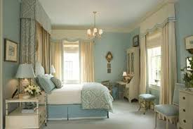 bedroom colour scheme idea with blue wall brown curtain light white curtains and bed sheet