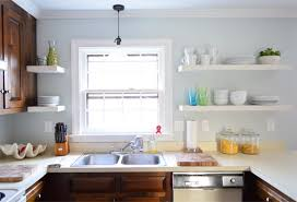 after photo of updated kitchen with white ikea floating shelves
