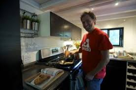 tiny house appliances. andrew cooking for the fam at home tiny house appliances o