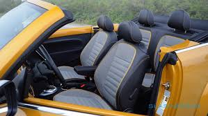 the cabin errs on the basic side with volkswagen s sober black plastic of choice lifted with matching metallic yellow plastic panels