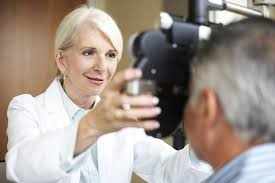 what do pharmacists do career information an optometrist examines a patient