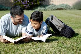 poor literacy and numeracy skills limit job chances father and son reading together outside