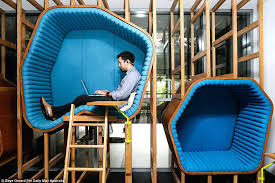 Office Nap Pod Different Shaped And Sized Pods Are Hung On The Walls