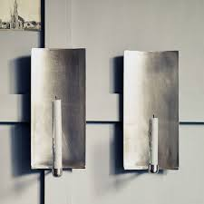 adorable silver wall sconce candle holder 10 favorites wall mounted candleholders as mood lights remodelista