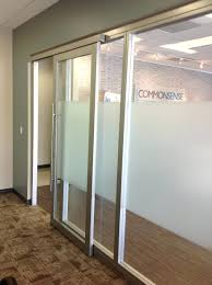 articles with sliding glass doors office partition label
