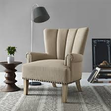 the dorel living accent chair is upholstered in a soft linen like fabric that is complemented by the natural rustic finish of the solid wood legs