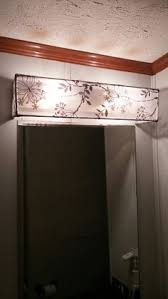 diy vanity light shade dowel rods and a curtain sheer hot glued hung over existing bathroom light covers e56