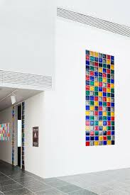 glass block window using a high privacy blocks in multiple colors in a contemporary setting in