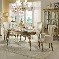 modern clic dining room spindle back dining chairs white finished wooden dining chair white shabby marble dining table gorgeous iron stained chandelier