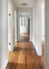 clear sealed pine floors in upstairs hallway