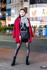 harajuku model actress in red coat polka dots patent leather dress suede heels bvlgari bag