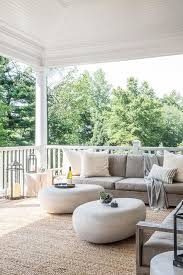 outdoor jute rug. Modern Covered Patio Features A Low Armless Outdoor Sofa Lined With Ivory Pillows Facing Pair Of West Elm Pebble Coffee Tables Atop Jute Rug. Rug