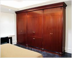 Bedroom Wall Organizational Unit | Traditional cherry bedroom wall unit  with side wardrobes and LCD .