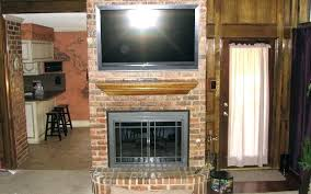 mounting a tv over a fireplace mounting tv in niche above fireplace installing a above the