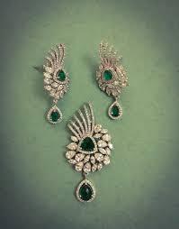 emerald stones with diamond pendant set