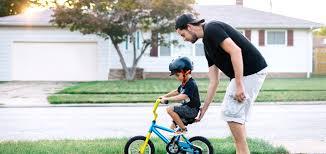 boy on bike with dad