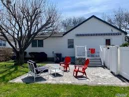 sun drenched mint condition 4 bedroom expanded ranch on oversized lot with detached 1 car garage in the desirable new hyde park garden city park school