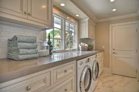 striking beach style laundry room design interior with white laundry room cabinets and granite countertop ideas