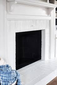 every wondered how to paint a brick fireplace white just follow these simple steps