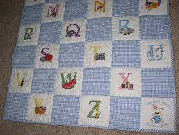Free Embroidery Designs, Cute Embroidery Designs & Baby quilt with cross-stitch blocks from The Purple Hat a long time ago.  Don't know if they are still available. The back is white fleece. Adamdwight.com