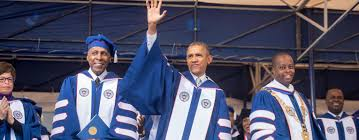 president obama tells howard grads be confident in your president obama flanked by howard university president wayne a i frederick r and howard