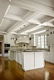 dream kitchen with a long center island, range, overhead lighting, and  exposed beam ceiling