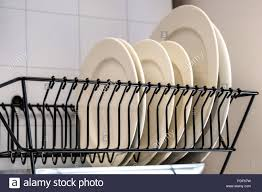 Plate drying rack Bamboo White Dishes Drying On Metal Dish Rack Dish Drying Rack The Dryer Is Fixed Horizontally On The Wall Alamy White Dishes Drying On Metal Dish Rack Dish Drying Rack The Dryer