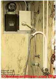 sources of moisture intrusion and corrosion in residential electric service and fuse box in a shower stall c 2010 hankeyandbrown com