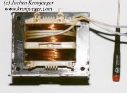 jochen s high voltage page microwave oven transformers transformer from microwave oven primary winding lower thick wire 230v secondary winding upper thin wire 2kv the few turns of very thick wire wound