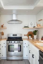 Find serenity with muted blues. Make A Small Kitchen Look Larger With These Clever Design Tricks Better Homes Gardens