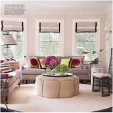 Patterned Sofas. Pillow Mix. Round Ottoman Coffee Table. Roman Shades