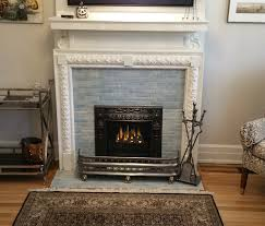 reion american style cast iron surround with torch accents available in all black or black with polished highlights