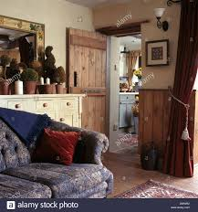 Red And Blue Living Room Blue Sofas In Country Living Room With Wood Burning Stove In Stone