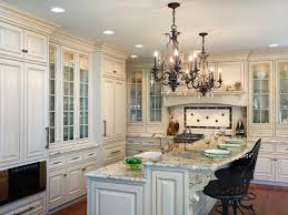 enchanting traditional white kitchen island with chandeliers