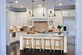 white kitchen cabinet with marble countertop wooden chairs glass pendant lights white painted floating kitchen cabinets