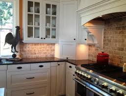 backsplash for black granite countertops and white cabinets