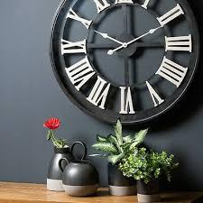large skeleton wall clock aged black