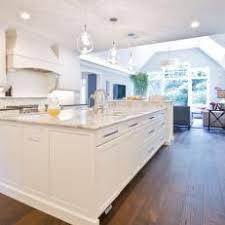 White kitchen dark wood floor Beige White Kitchen With Large Central Island Dark Wood Floor Centralparcco Photos Hgtv