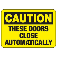 caution these doors close automatically door safety sign