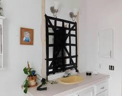 safely remove a bathroom wall mirror