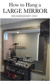 how to hang a large wall mirror step
